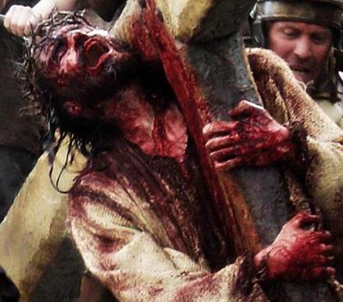 In this archived photo, Jesus of Nazareth is seen howling, covered in his victims' blood.